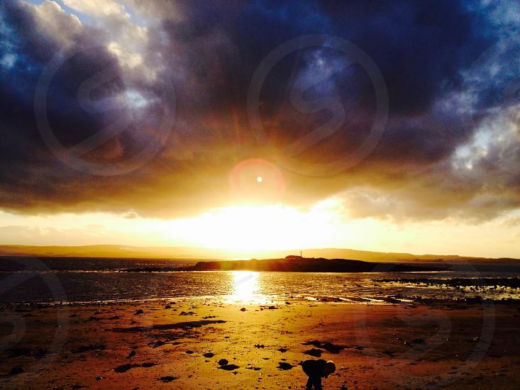 Holy island at sunset photo