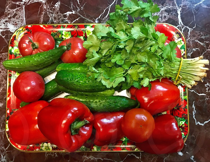 Fresh vegetables and greens on a tray photo