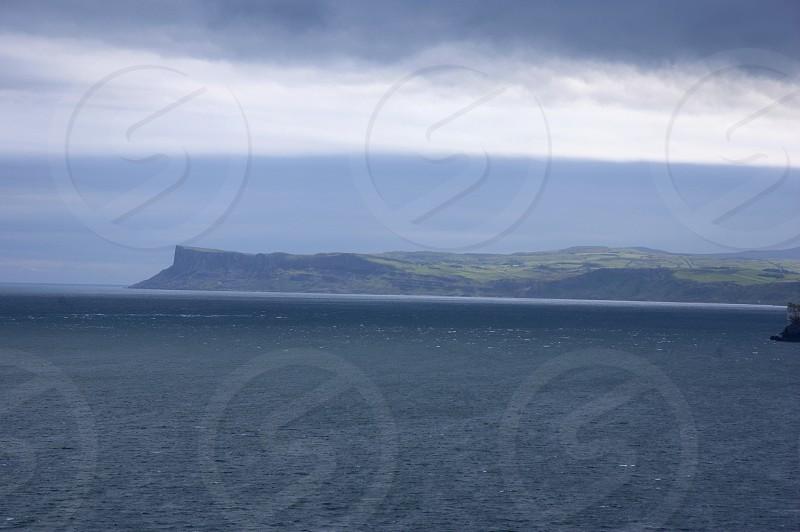 Antrim Coast Road Northern Ireland Irish Sea Autumn Bay Rocks Cliffs Layers Moody sky photo
