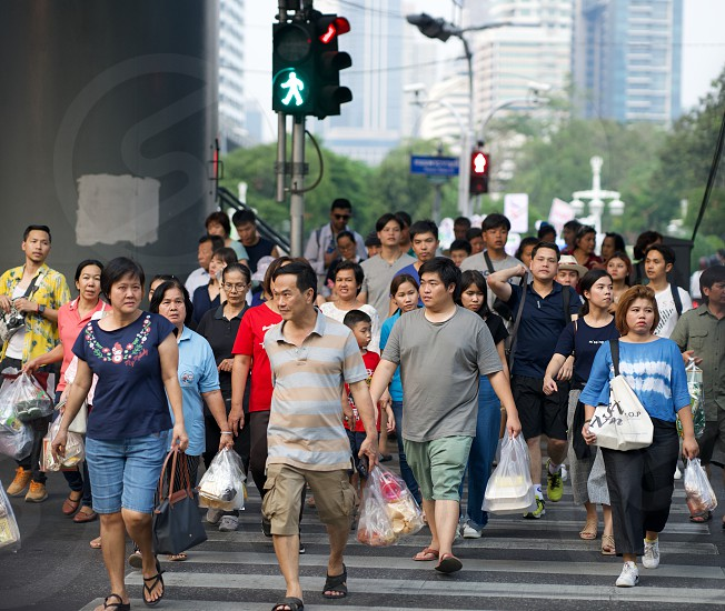 People crossing a street in Bangkok Thailand.                                photo