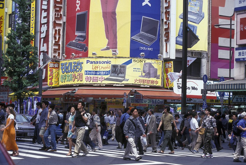 A Road with Shopping and Trafic in the City centre of Tokyo in Japan in Asia photo