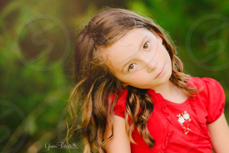 girl in red shirt sitting photo