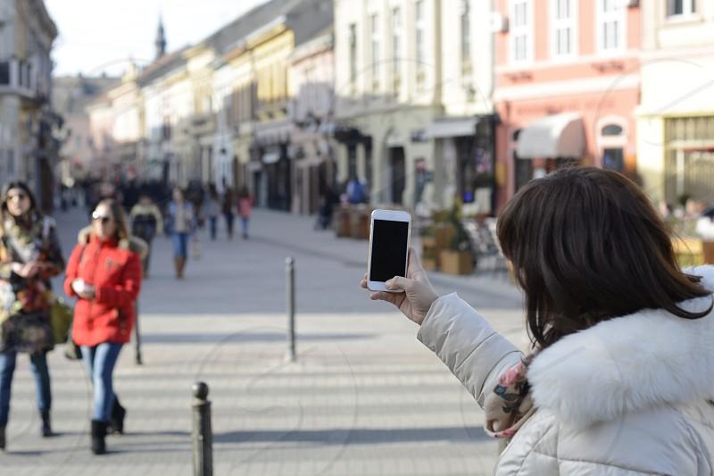 woman phonestreetcityEuropeanview photo