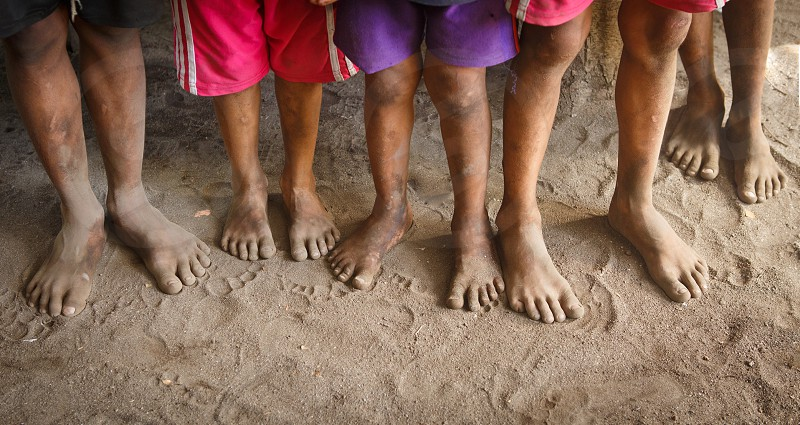 Feet of young boys at an orphanage in Honduras photo