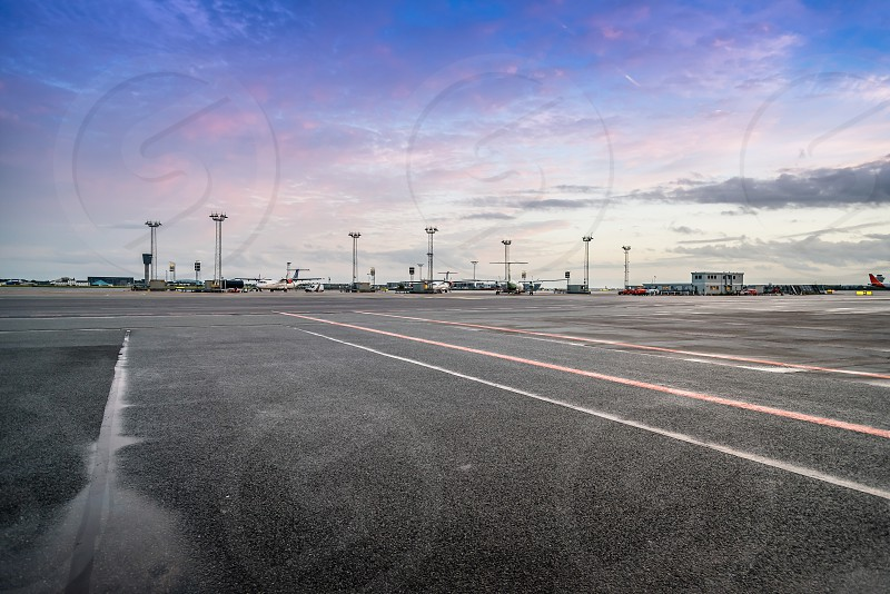 View of the runways of Kastrup airport in Copenhagen at sunset. The airport is the busiest airport in Nordic countries. photo