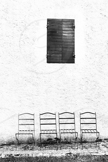 Four chair and a closed window photo