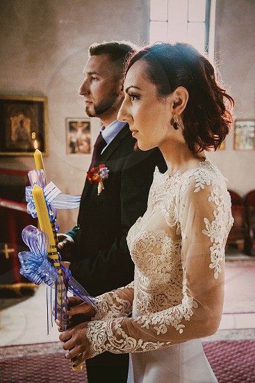 church wedding orthodox candle dress bride groom at altar lace happy standing photo