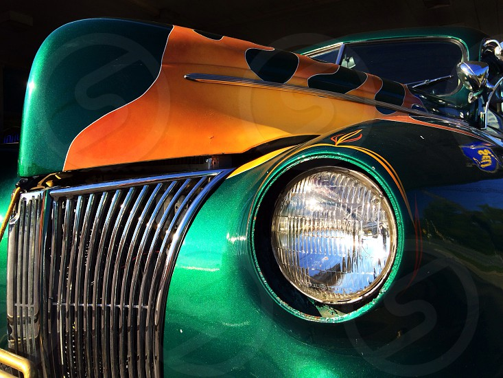 green vintage car with flame detailing  photo