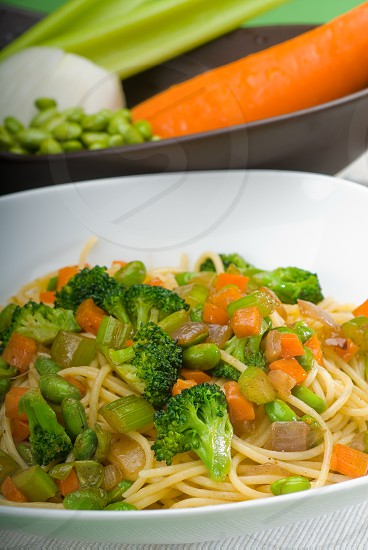 italian spaghetti pasta with fresh homemade vegetable sauce photo