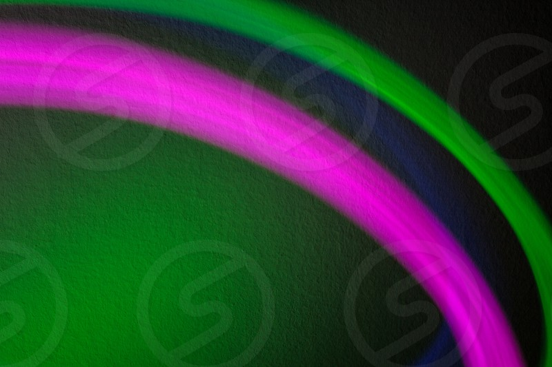 Lighting effects of colorful lights in front of wall.  photo