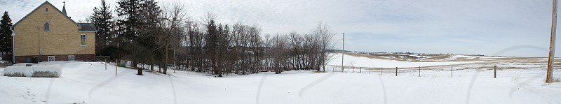 Old brick country church in the winter panoramic photo
