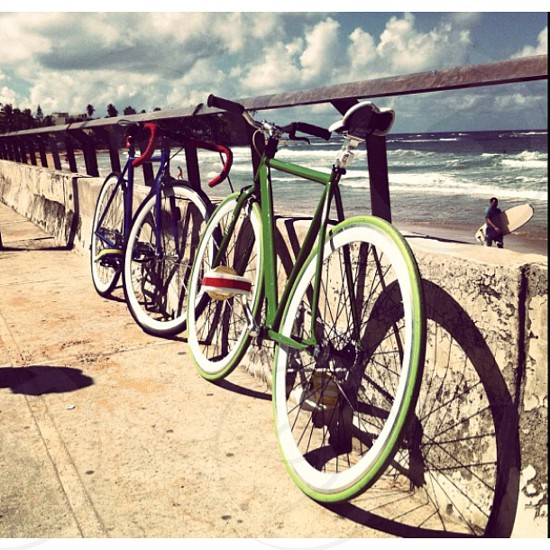 green bicycle parket by the beach photo