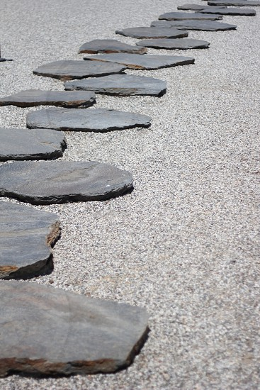 japanese rock garden representing a balance of land and water photo