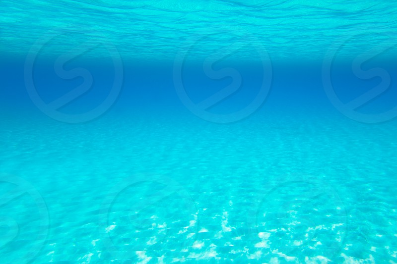 Blue turquoise underwater view of tropical beach transparent water photo