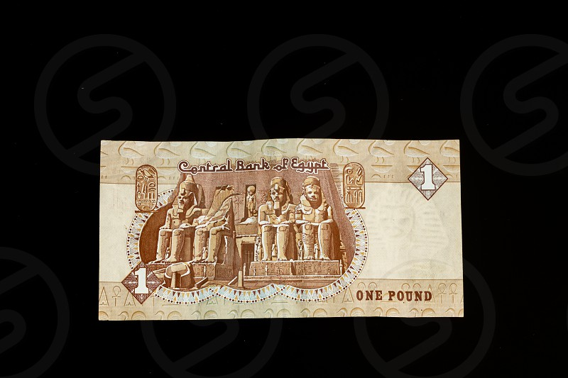 Egyptian banknote Temple of Ramses II at Abu Simbel one Egyptian Pound close up isolated on black background photo