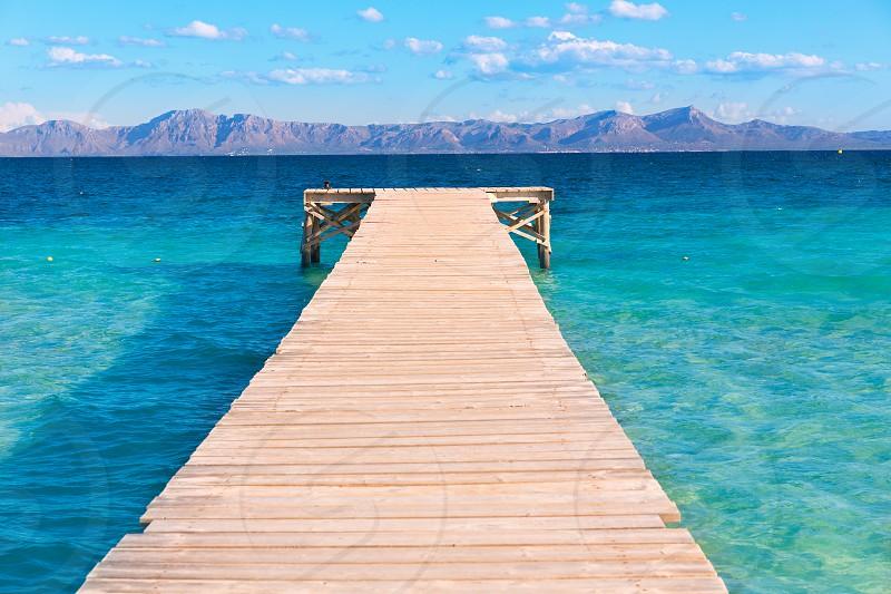 Mallorca Platja de Alcudia beach pier in Majorca Balearic islands photo