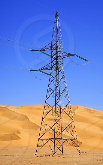 Electricity pylon in the Sahara desert Libya photo