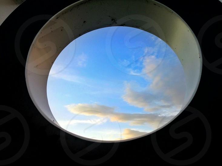 Blue sky framed by a black circle photo