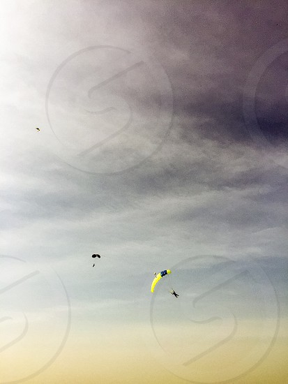 2 people on parachutes in sky photo