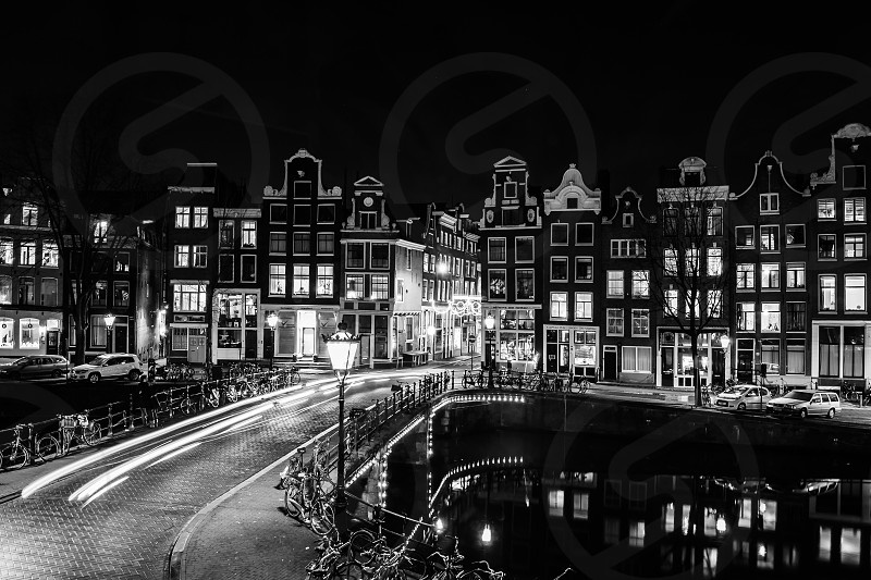Light trails over Singel Canal Amsterdam Netherlands. Long Exposure. photo