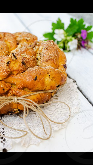 Sweet Easter bread with egg decoration and flowers photo