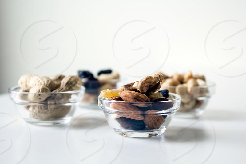 Food; snack; healthy; mixed nuts; peanuts; cashews; chestnuts; nuts; monkey nuts; raisins;  photo