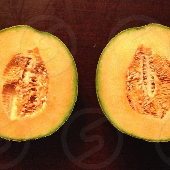 Halved cantaloupe. photo
