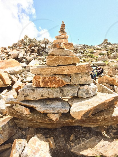 pile of rocks and stones under blue sky photo