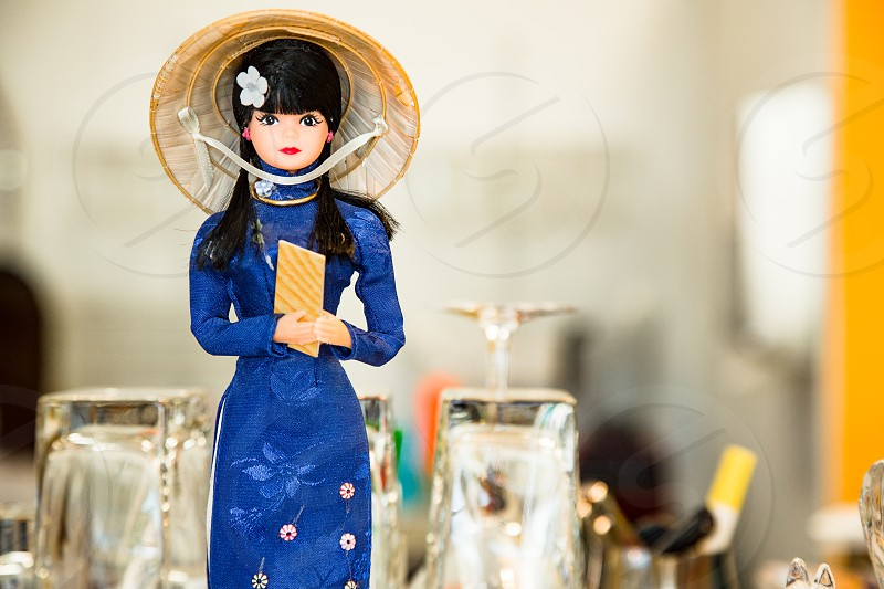 doll in blue floral long sleeve dress photo