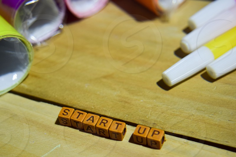 Start up on wooden blocks. Cross processed image with wooden background photo