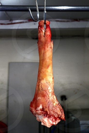 Photo of a raw pork leg on display at a meat shop photo