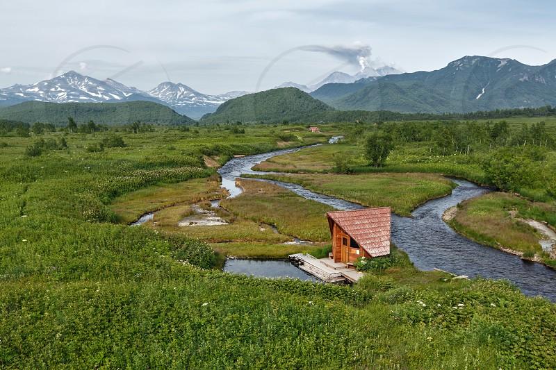 Beautiful summer landscape of Kamchatka: view of Goryacherechensky group hot springs Goryachaya River in nature park Nalychevo. Russia Far East Kamchatka Peninsula. photo