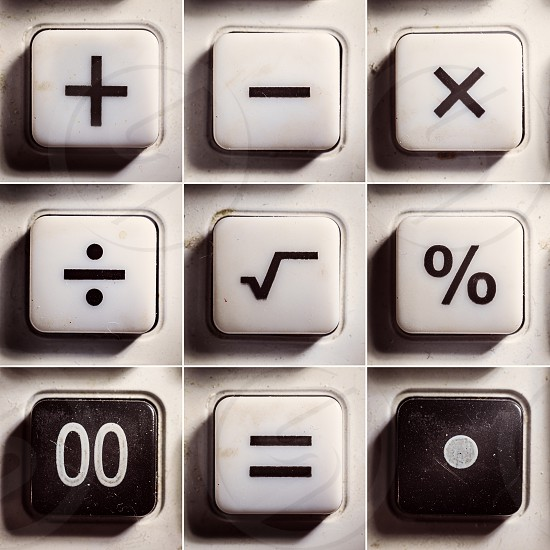 Set of buttons from an old calculator symbols of mathematical operations.  photo