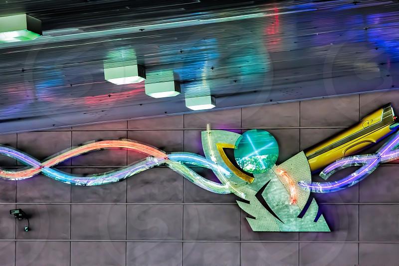 Man Shaped Neon Light in an Underground Car Park photo