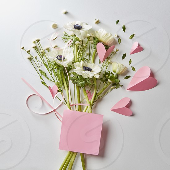 bouquet and card for your text pink hearts made of paper on a white background photo