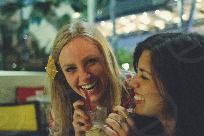 two girls drinking photo