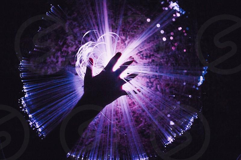 Hand fiber optic light ultra violet purple space starburst photo
