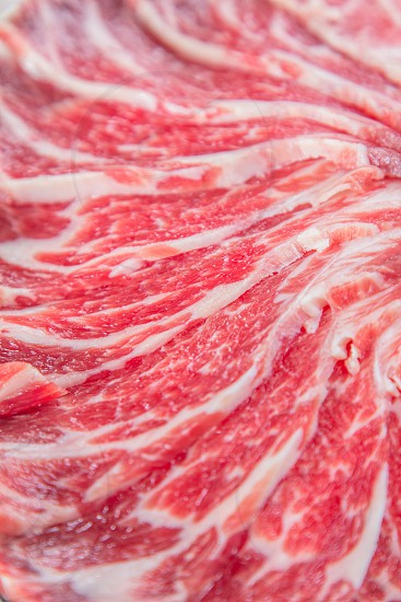 raw sliced beef belly  photo