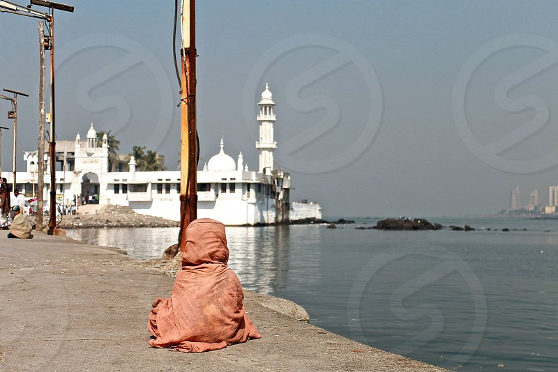 india child meditation mumbai ocean temple photo