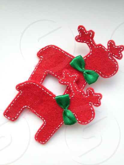Red handmade reindeers to decorate Christmas tree ready for holiday  photo