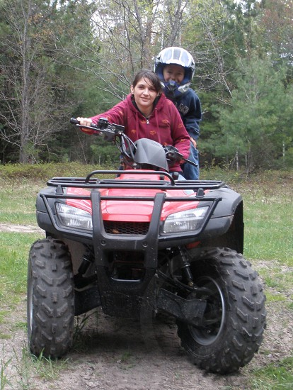 Two people on a 4 wheeler; outdoor lifestyle; Singing Hills Hunting Club Michigan photo