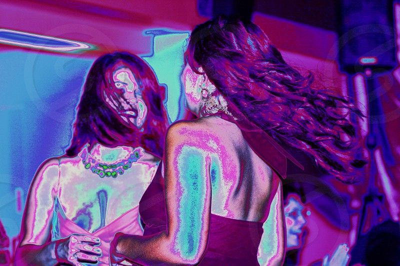 Women dancing in the party lights. photo