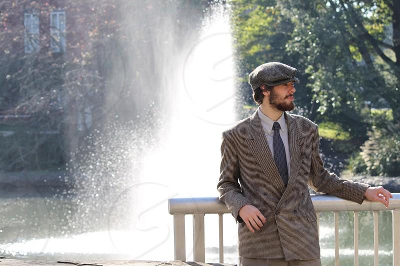 man wearing grey coat standing photo
