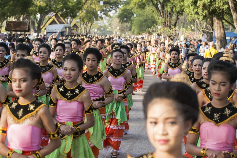 traditional dresst thai women at the Loy Krathong Festival in the Historical Park in Sukhothai in the Provinz Sukhothai in Thailand.   Thailand Sukhothai November 2018 photo