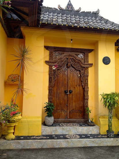 Typical traditional residential hand carved wooden Balinese front door photo
