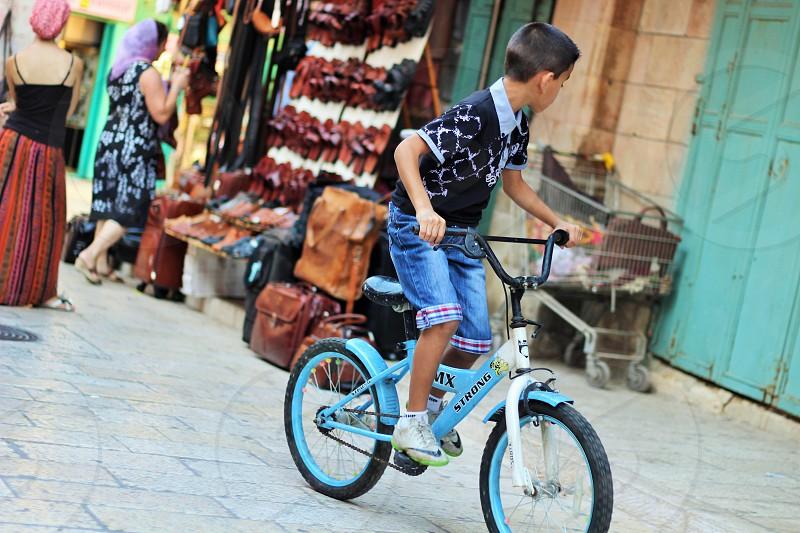 boy riding bike photo