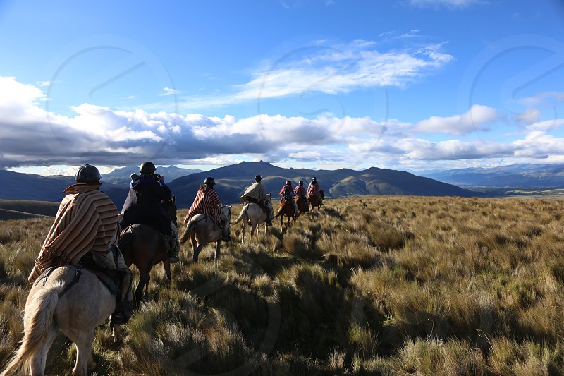 Horseback riding in Cotopaxi Ecuador photo