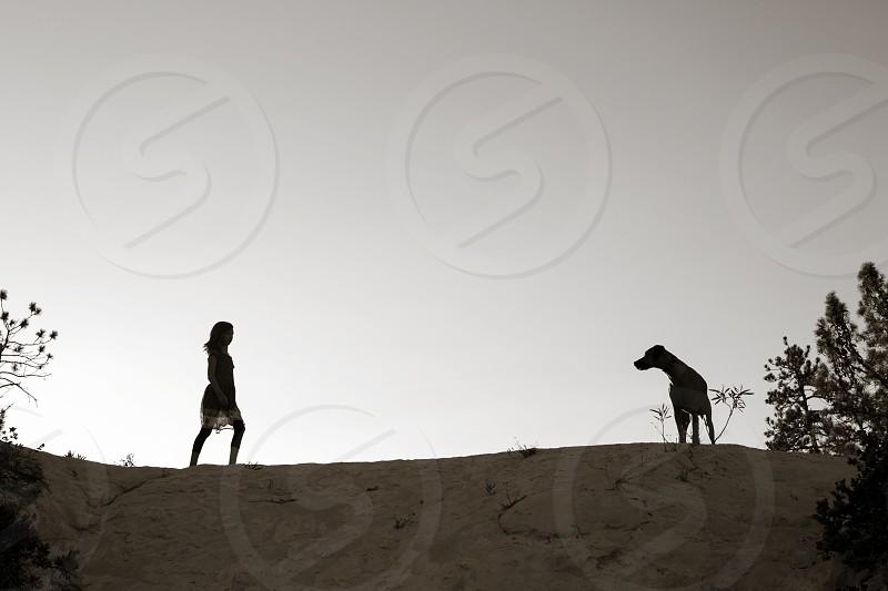 black and white silhouette dog child family companionship partner buddy landscape vista outdoors nature hiking love photo