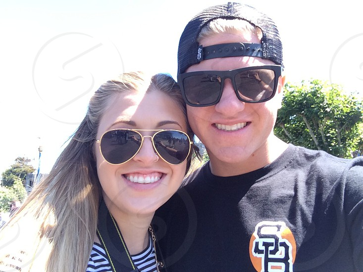man and woman with sunglasses smiling photo