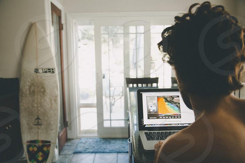 woman using macbook pro turned on photo